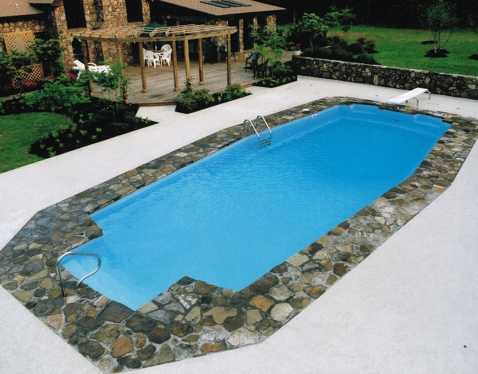 Stunning in-ground fiberglass seamless pool by Catalina Pools