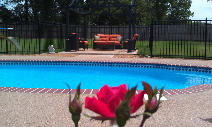 Beautiful in-ground pool with seating area
